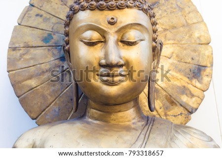 golden buddha head ( face ) on white background
