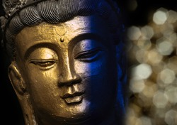 golden buddha head on black background