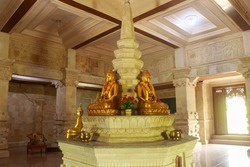 Golden Buddha in the Buddhist temple Brahma Vihara Arama, Bali, Indonesia. Yellow Buddha look beautiful