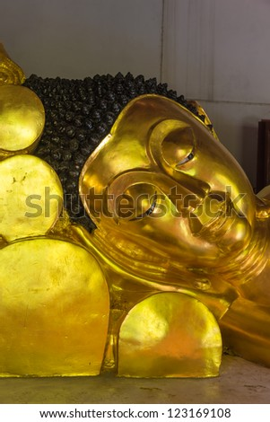 Golden Buddha sculpture Close-up to face at the temple, Thailand