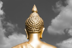 Golden Buddha statue from back focused on head