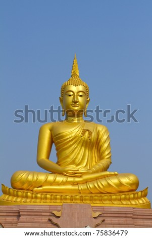 Golden Buddha statue in a Buddhist  temple - stock photo