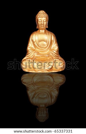 Golden Buddha statue isolated on black