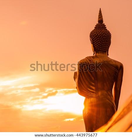 Golden Buddha statue standing on a mountain at  Wat Phra That Khao Noi, Nan Province, Thailand