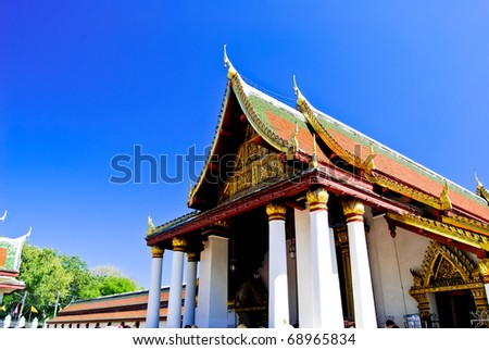Golden Buddha temple on the blue sky , Asia , Thailand