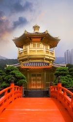 Golden buddhism tower with red bridge and blue sky in China.