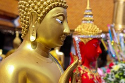 Golden Budha Near the Temple in Chiang Mai Thailand