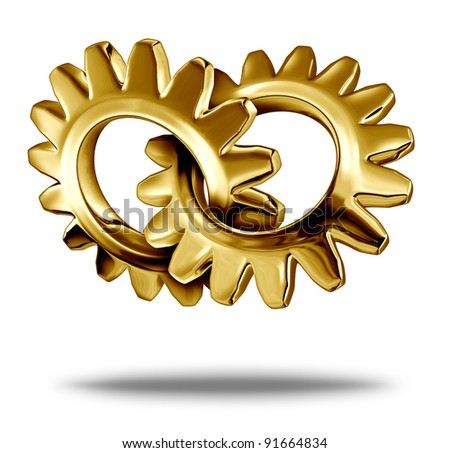 Golden business partnership concept with two gold metal gears or cogs connected together as a symbol of strategic corporate merger and  company teamwork.