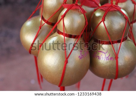 Golden Calabashes souvenir. The Thai words mean