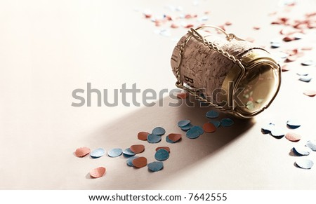 golden champagne cork with confetti