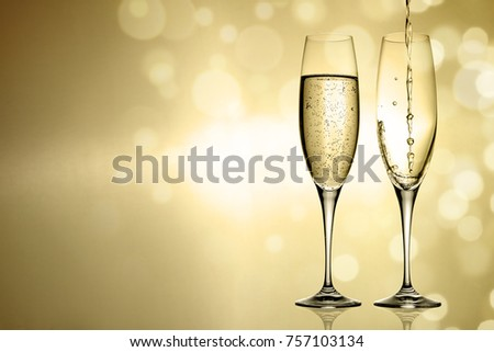 golden champagne on golden background with space for advertising text #757103134