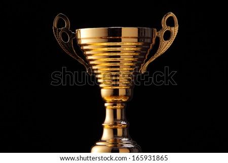 golden champion trophy on the black