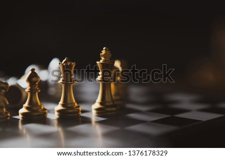 Golden Chess game King,Queen,Bishop staying on board,Business planing strong concept with dark background. #1376178329