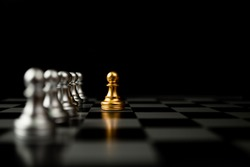 Golden Chess pawn standing in front of other chess, Concept of a leader must have courage and challenge in the competition, leadership and business vision for a win in business games