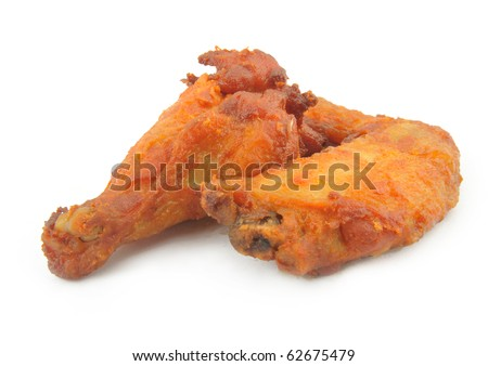 Golden chicken wing and leg - stock photo