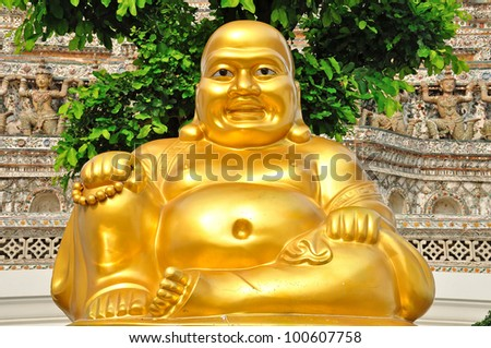 Golden chinese buddha statue in Wat Arun in Bangkok, Thailand