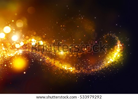 Golden Christmas and New Year glittering stars swirl on black bokeh background. backdrop with sparkling golden stars, holiday garland, magic glowing dust, lights. Gold Abstract Glitter Blinking sparks
