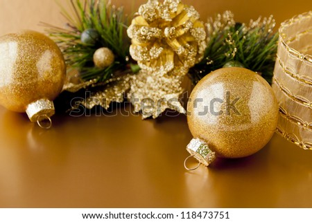 Golden Christmas background with balls and pine cone. selective focus, shallow dof