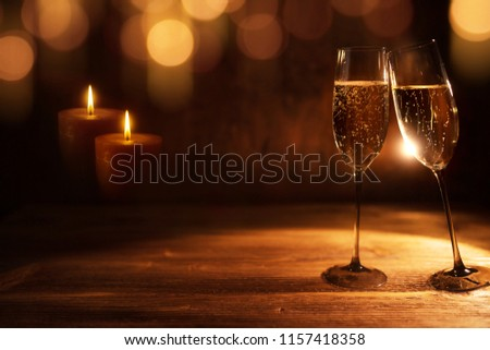 Golden christmas background with festive bokeh and tingling champagne  #1157418358