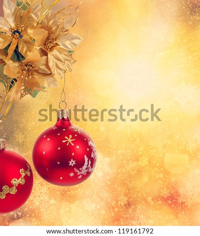 golden christmas background with red balls and snowflakes