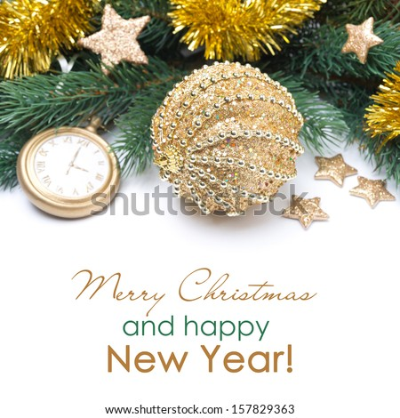 Golden Christmas ball and spruce branches isolated on white
