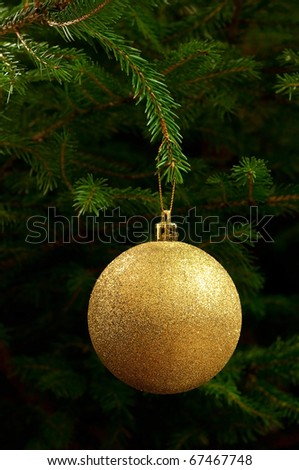 golden christmas ball hanging on the tree