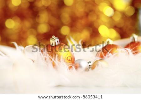 golden christmas ball on a furry background, christmas balls
