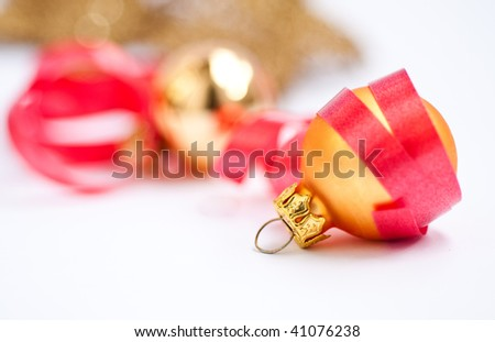 Golden Christmas ball with red garland #41076238