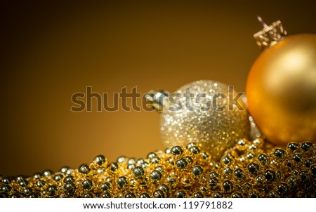 golden Christmas balls on a gold background