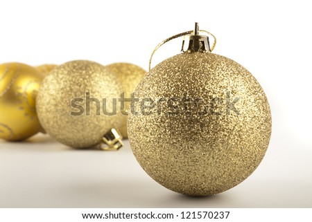 Golden Christmas balls on the table