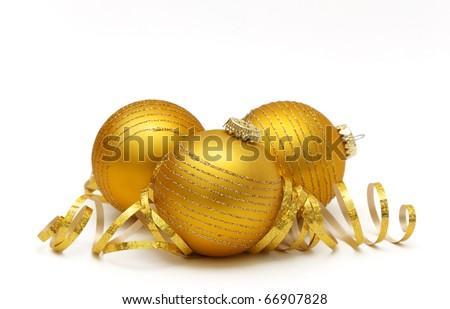 Golden christmas balls over white background