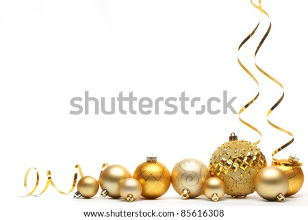 Golden Christmas balls with ribbons isolated on white.