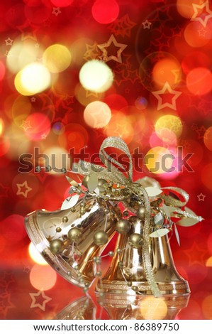 Golden Christmas bell tree decorations on lights background