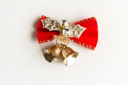 Golden christmas bell with red bow isolated on white background, top view