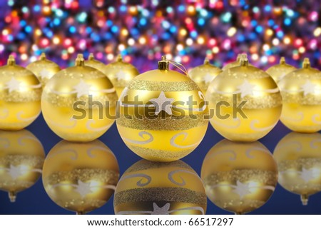 golden christmas decoration balls on christmas lights background