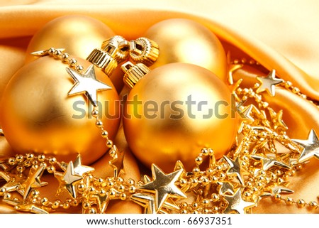 Golden Christmas decoration on satin textile
