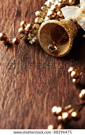 Golden christmas decoration on wooden background