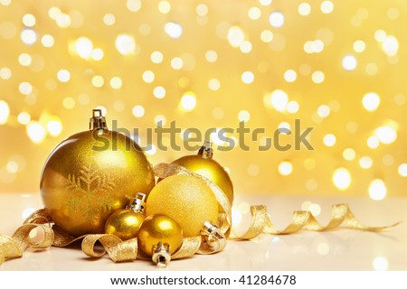 Golden Christmas ornaments with blur light on background