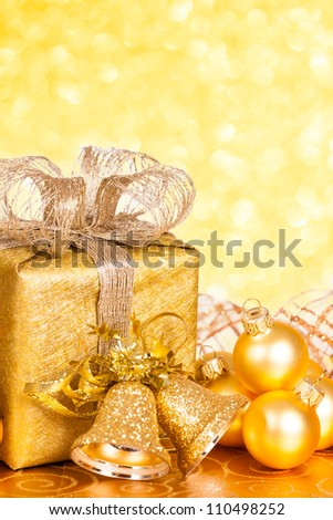 Golden Christmas tree decorations against lights background - stock photo