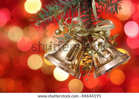 Golden Christmas tree decorations on lights background