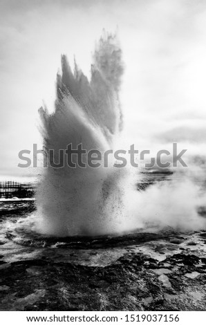 Golden Circle, Iceland: Black and white eruption of Strokkur geyser located in a geothermal area beside the Hvita River in Iceland, east of Reykjavik, one of Iceland's most famous geysers. Stock fotó ©
