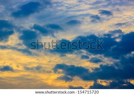 Golden clouds on the sunrise sky