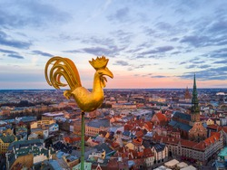 Golden cock on the top of the Dome Cathedral during sunset over Riga. Beautiful wallpaper.