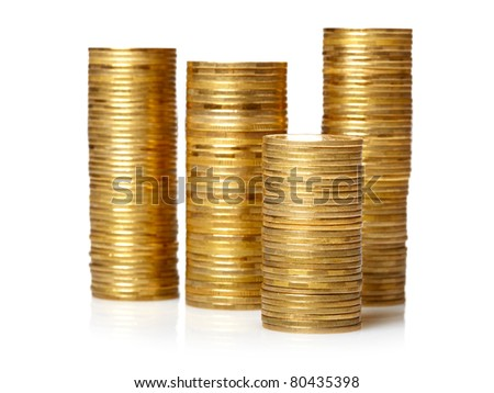 Golden  coin stacks isolated over white
