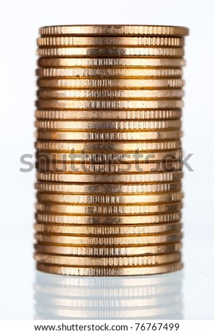 Golden coins stacks on white