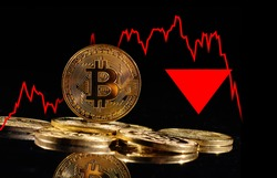 Golden coins with bitcoin logo drop at bear market. Pullback of leader cryptocurrency Bitcoin BTC in trading. Decentralized digital currency fell. Crypto collapse. Electronic money on black background