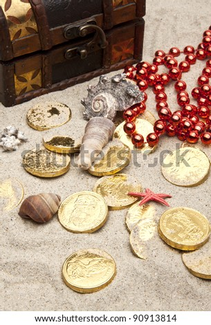 golden coins with marine treasures