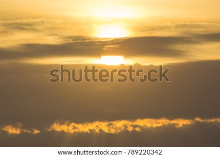 golden color from sunrise over clouds in the morning, nature background #789220342