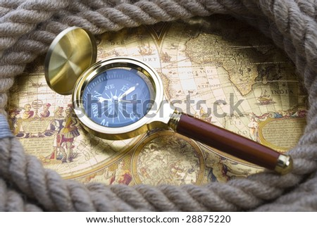 Golden compass and magnifier #28875220
