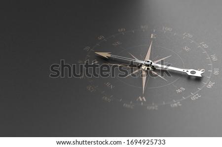Golden compass over modern black background. Concept of business guidance or orientation, 3D illustration. Stockfoto ©